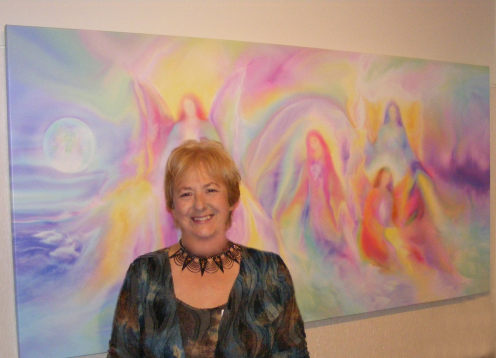 Glenyss with her painting Co Creation at Sanctuary Angel Gallery in Australia